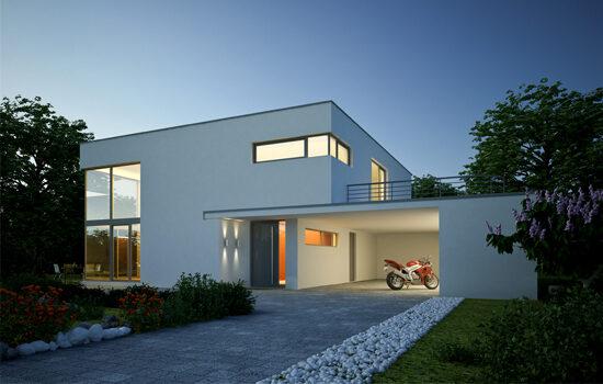 Modernes Haus bei Nacht mit Motorrad